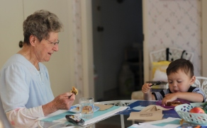Grandma GG and Paul enjoying a snack together